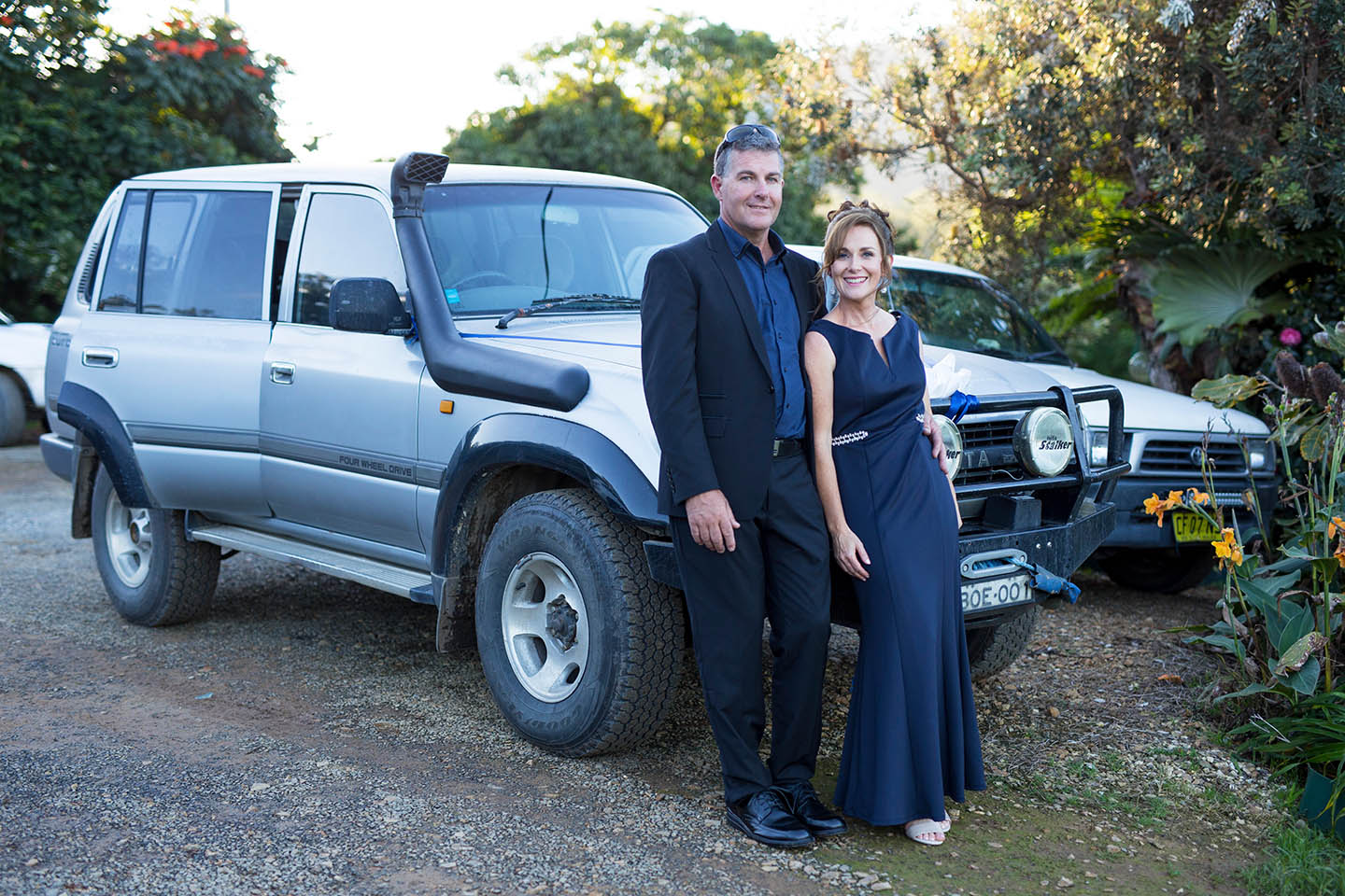 Bride and groom posing in front of their car, couple, lovers, wedding, Alice Payne photography