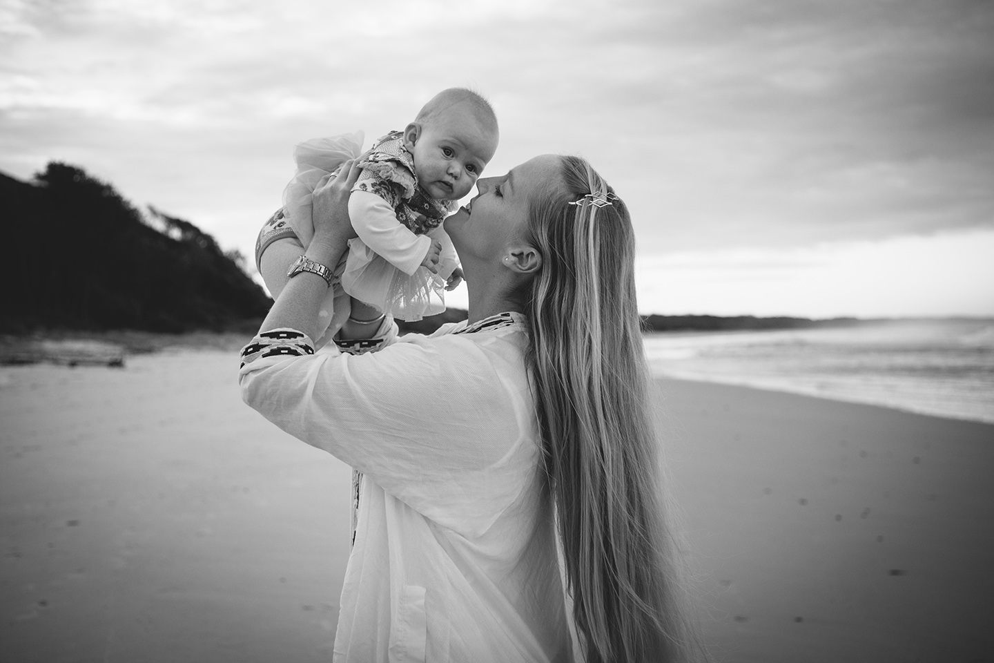 Mother holding high baby daughter, family photography, Alice Payne photography