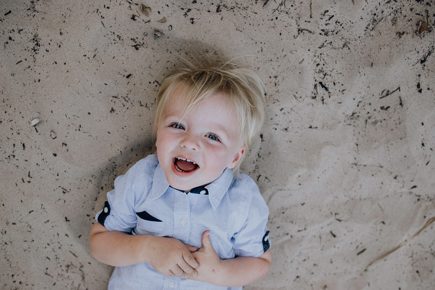 Little boy laying in the sand, family photography, Alice Payne photography