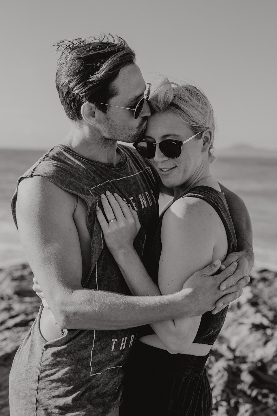 couple kissing and holding at the beach, b&w image, Alice Payne photography