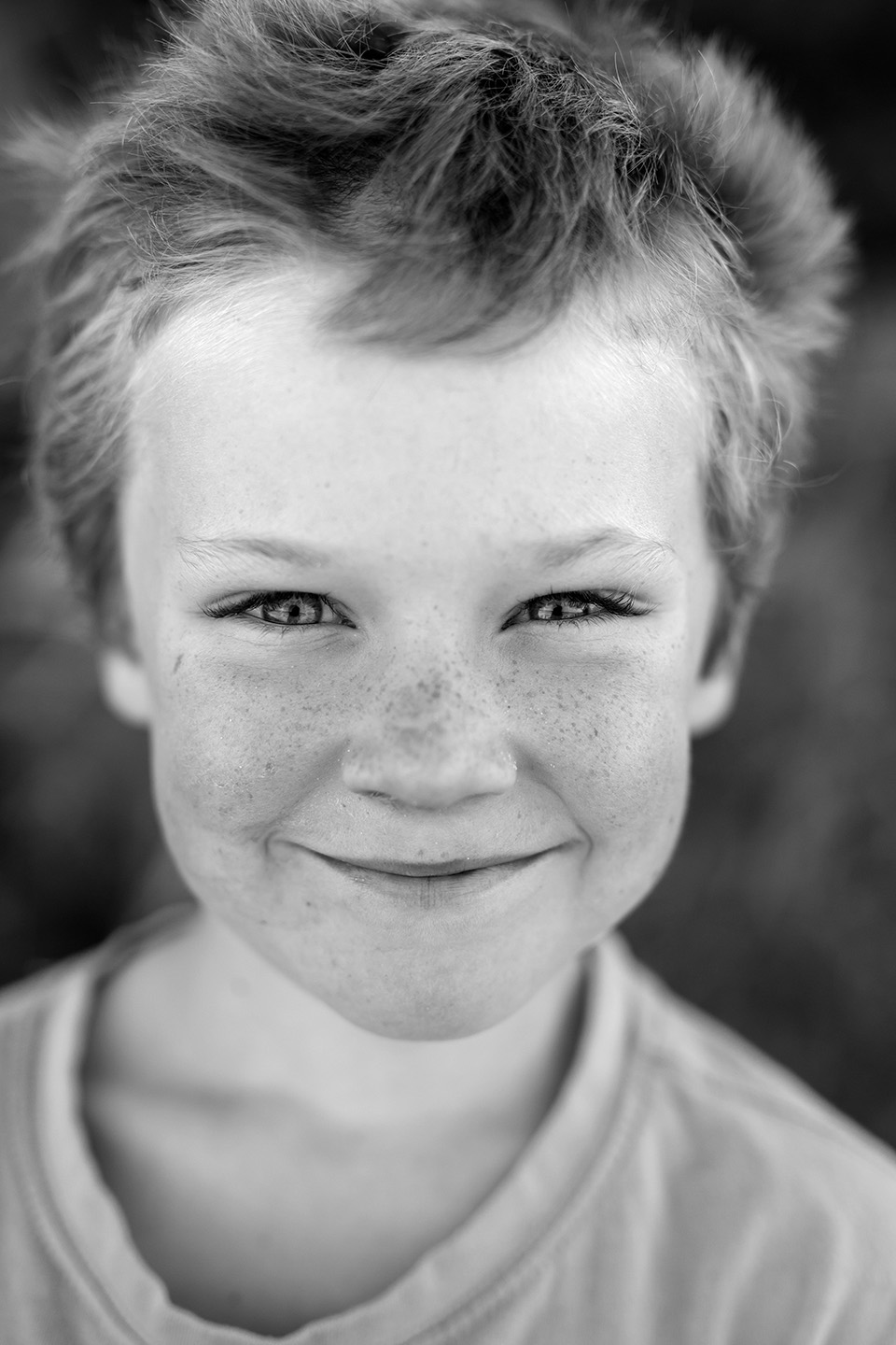 Little boy smiling, b&w photo, Alice Payne photography