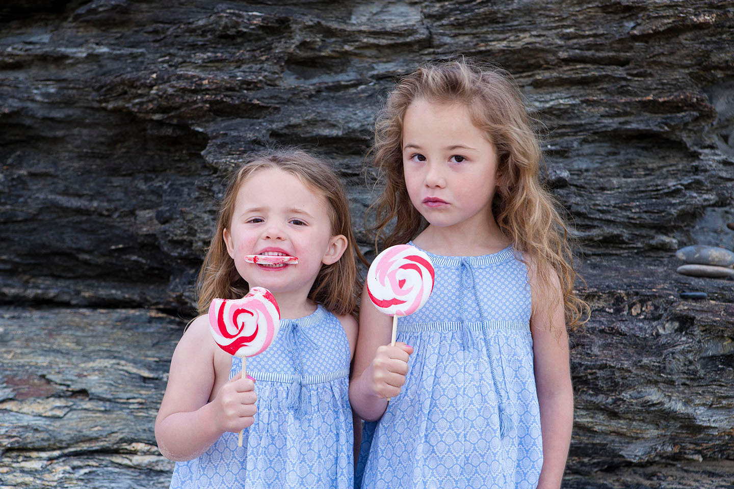 Sisters, family photography, childhood, beach, lollipops,Alice Payne photography