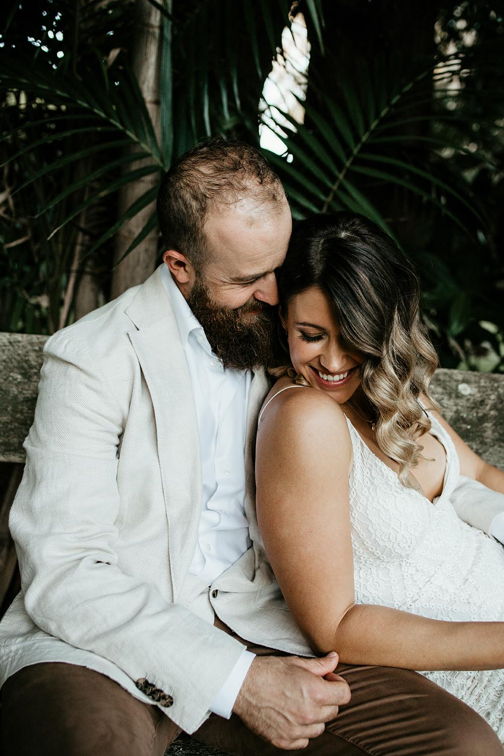 Bride and groom sitting cuddling smiling - coffscoast wedding photographer - Nambucca valley wedding photographer - Nambucca heads wedding photographer - Bellingen photographer - elopment - couple in love