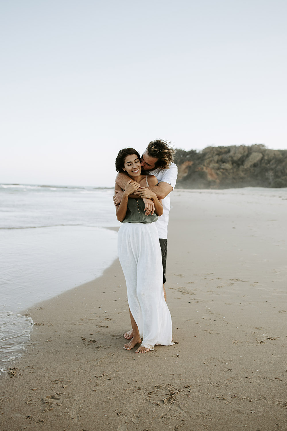 Couple kissing cuddling at the beach - Nambucca valley photographer - Couple photography -bellingen wedding photographer