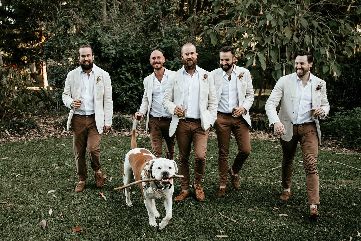 Groom with his groomsmen and a dog  walking and laughing - nambucca valley wedding photographer -Bellingen photographer - Coffs coast wedding photographer - elopment - Nambucca heads photographer