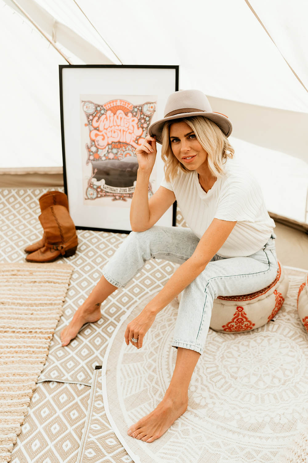 Model sitting on a cushion holding her hat - Business branding photography - Nambucca valley photographer - Lifestyle photographer - Bellingen photographer - Coffs coast photographer