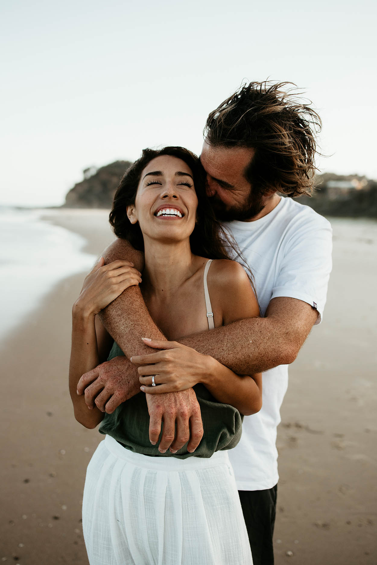 Couple cuddling laughing at the beach - mid north coast wedding photographer - nambucca valley wedding photographer - Lovers -