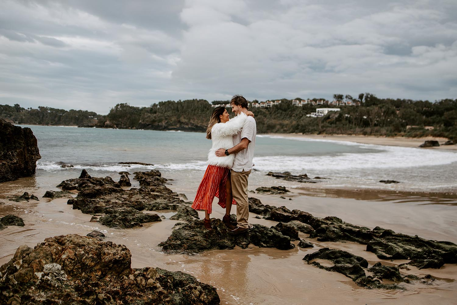 Couple embracing smiling looking at each other at the beach - coffs harbour wedding photographer - Bellingen wedding photographer - Nambucca valley wedding photographer